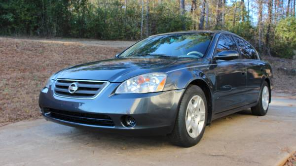 STATE FARM INSURANCE RATE QUOTE FOR 2002 NISSAN ALTIMA SE SEDAN 4 DOOR $72.93 PER MONTH 1114103155