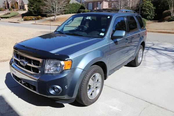 Travelers Insurance Rate Quote For 2011 FORD ESCAPE XLT 4WD WAGON 4 DOOR - 3.0L V6  FI  DOHC     NF4 $145.21 Per Month 9416999