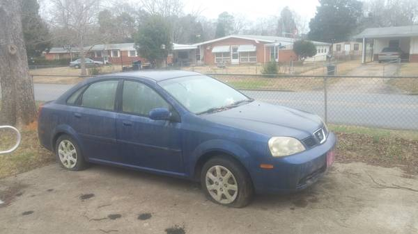 Insurance Quote For 2005 SUZUKI FORENZA S 2WD SEDAN 4 DOOR - 2.0L L4  SFI DOHC 16V NS $34 Per Month