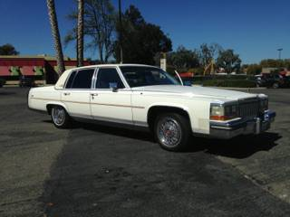 Insurance Rate for 1987 Cadillac Brougham Base - Average Quote $75 per Month
