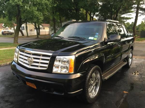 Insurance Rate for 2002 Cadillac Escalade EXT Sport Utility Truck - Average Quote $89 per Month